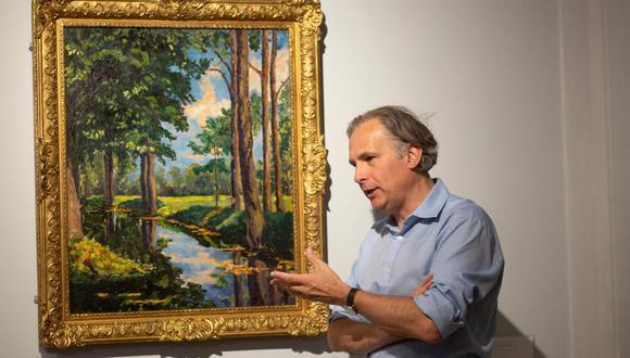 """La pintura al óleo, titulada """"The Moat, Breccles"""", había sido valorada entre 1,5 y 2 millones de dólares, lejos de los 11,6 millones de dólares esperados por otro cuadro del mismo autor, vendido por Angelina Jolie en marzo. (Foto: Kena Betancur / AFP)"""