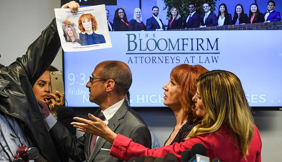 """Comedian Kathy Griffin (2ndR) speaks at a news conference to discuss the comedian's """"motivation"""" behind a photo of her holding what appeared to be a prop depicting US President Donald Trump's bloodied, severed head, as a man holds up the image of Griffin holding the head, with her attorney, Lisa Bloom (R) in Woodland Hills, California on June 02, 2017.  / AFP / Mark RALSTON"""