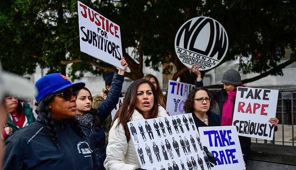 Sonia Ossorio, center, president of the National Organization for Women of New York, leads a group in protest, after Bill Cosby arrives for his sexual assault trial at the Montgomery County Courthouse, Monday, April 9, 2018, in Norristown, Pa. (AP Photo/Corey Perrine)