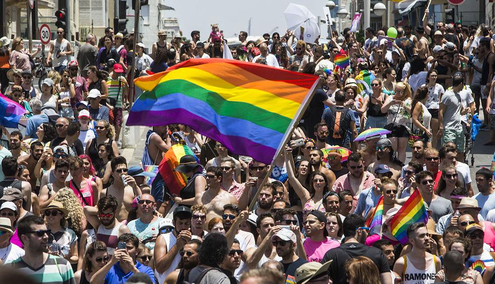 Israelis and tourists march during the Gay Pride Parade in Tel Aviv Israel Friday, June 9, 2017. About 200,000 people from the LGBT community in Israel and abroad attended in Tel Aviv's annual gay pride parade. (AP Photo/Sebastian Scheiner)