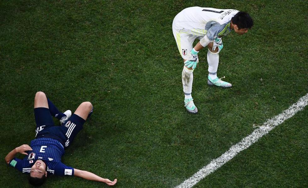 Gen Shoji y Eiji Kawashima sin poder creer la derrota a manos de Bélgica. (Foto: AFP)