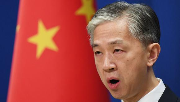 """El portavoz de Exteriores chino Wang Wenbin dijo en su rueda de prensa diaria que es """"habitual para Estados Unidos utilizar su poder estatal para atacar violentamente a las compañías de otros países"""", como es el caso de TikTok. (Foto: GREG BAKER / AFP)."""