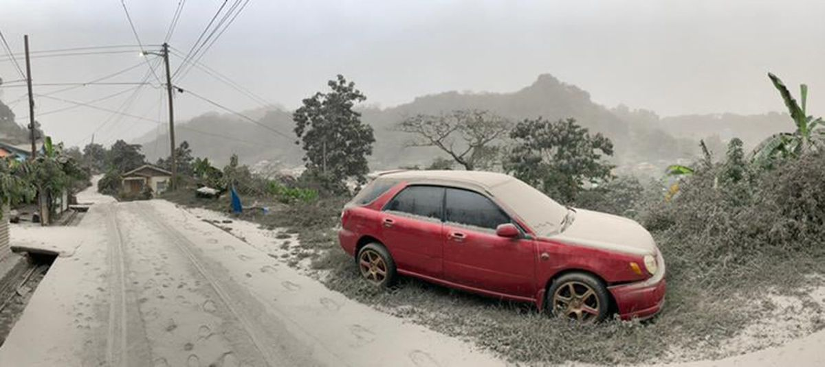 A car and a road covered in volcanic ash. (AFP).
