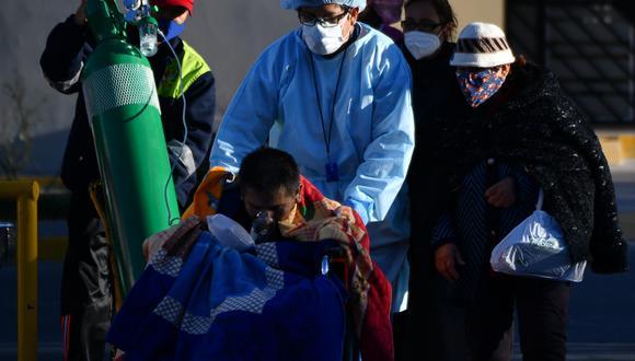 Un paciente infectado con COVID-19 en el Hospital Honorio Delgado de Arequipa. Hasta el momento la cifra de infectados llegó a 762.865 según el reporte del Minsa.  (Foto: AFP)