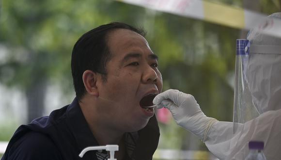 Beijing hace pruebas de coronavirus a todos los trabajadores de delivery. (Foto: by STR / AFP).