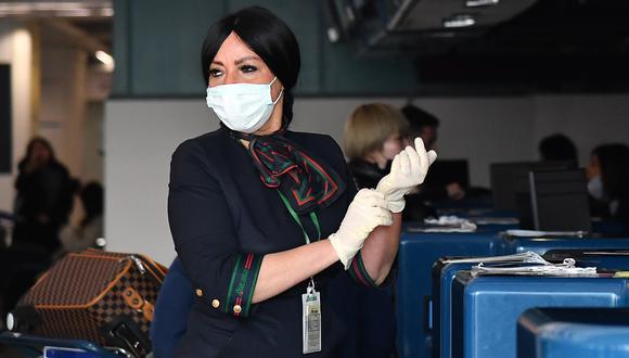 Los controles se han incrementado en China ante el incremento de casos de neumonía de Wuhan. (Foto: Tiziana FABI / AFP)