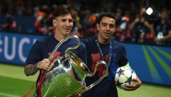Para ilustrar su mensaje de apoyo, Lionel Messi colgó una fotografía a través de Instagram en la que celebra con Xavi un gol en el estadio Camp Nou. (Foto: AFP)