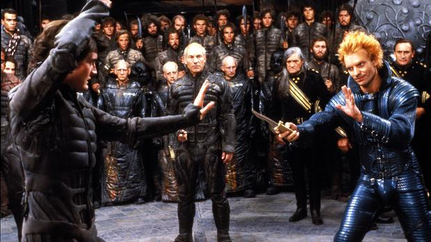 """Kyle MacLachlan (left) and Sting (right) at """"Dune"""" (1984) by David Lynch.  In the center is actor Patrick Stewart in the role of Gurney Halleck.  (Photo: Universal Pictures)"""
