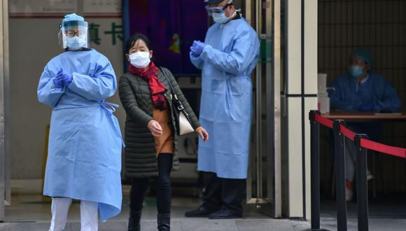 China asegura no tener ya enfermos graves por el coronavirus. (AFP / Hector RETAMAL)