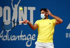El tenista alemán Benjamin Hassan jugó un partido con una mascarilla en el rostro