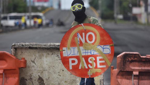 Según la Defensoría del Pueblo, la violencia asociada a las protestas deja al menos 19 muertos en toda Colombia, así como 254 civiles y 457 policías heridos. (Foto: EFE/ Ernesto Guzmán Jr.)