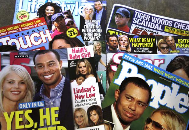 """Magazines featuring Tiger Woods are photographed Wednesday, Dec. 2, 2009, in New York. Woods said he let his family down with """"transgressions"""" he regrets """"with all of my heart,"""" and that he will deal with his personal life behind closed doors, in a statement released Wednesday. (AP Photo/Julie Jacobson)"""