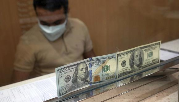 El dólar se negociaba en 4.1 millones de bolívares soberanos este martes en Venezuela. (Foto: AFP)