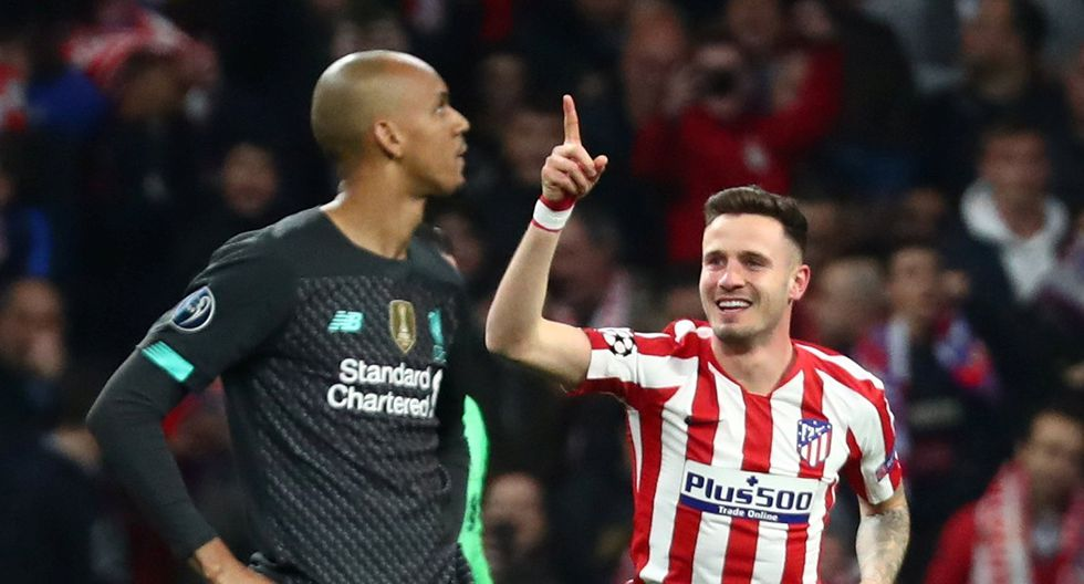 Soccer Football - Champions League - Round of 16 First Leg - Atletico Madrid v Liverpool - Wanda Metropolitano, Madrid, Spain - February 18, 2020  Atletico Madrid's Saul Niguez celebrates scoring their first goal as Liverpool's Fabinho looks dejected   REUTERS/Sergio Perez