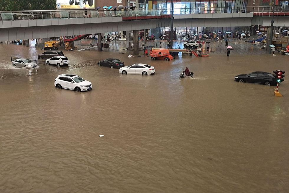 According to scientists, climate change is exacerbating floods and other extreme weather events around the world.  (Photo: STR / AFP).