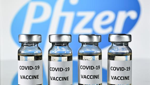 An illustration picture shows vials with Covid-19 Vaccine stickers attached, with the logo of US pharmaceutical company Pfizer, on November 17, 2020. (Photo by JUSTIN TALLIS / AFP)