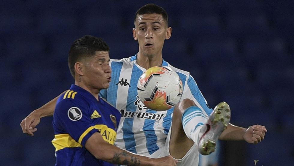 Boca Juniors' Colombian Jorman Campuzano (L) and Racing Club's Matias Rojas vie for the ball during their Copa Libertadores all-Argentine quarterfinal football match at La Bombonera stadium in Buenos Aires on December 23, 2020. (Photo by Juan Mabromata / POOL / AFP)