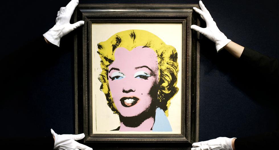 Una pintura llamada 'Lemon Marilyn',  de Andy Warhol, fechada en 1962, durante una exhibición de arte impresionista y moderno en la casa de subastas Christie's en Londres. (Foto: AFP)