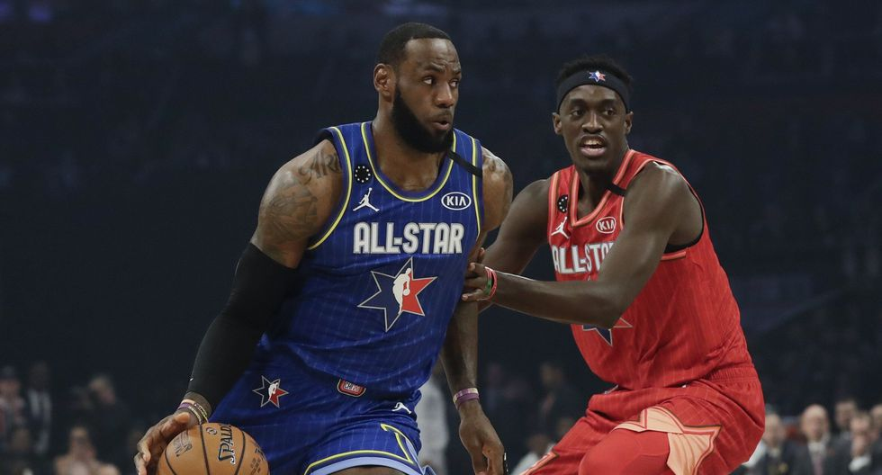 LeBron James of the Los Angeles Lakers dribbles past Pascal Siakam of the Toronto Raptors during the first half of the NBA All-Star basketball game Sunday, Feb. 16, 2020, in Chicago. (AP Photo/Nam Huh)
