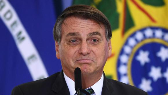Jair Bolsonaro minimiza la crisis sanitaria, mientras medio Brasil está por colapsar por el coronavirus. (Foto: EVARISTO SA / AFP).