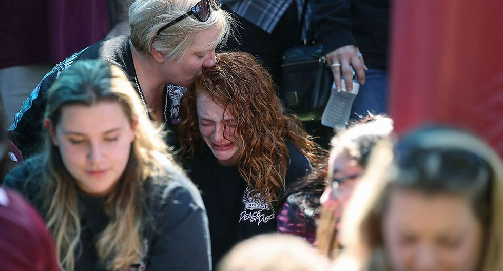 PARKLAND, FL - FEBRUARY 15: 16 year old Alyssa Kramer (C), gets a hug from her mother Tonja Kramer during a prayer vigil for famlies of Marjory Stoneman Douglas High School, where a mass shooting took place, at the Parkridge Church, on February 15, 2018 in Parkland, Florida. Yesterday Police arrested 19 year old former student Nikolas Cruz for killing 17 people at the high school.   Mark Wilson/Getty Images/AFP == FOR NEWSPAPERS, INTERNET, TELCOS & TELEVISION USE ONLY ==