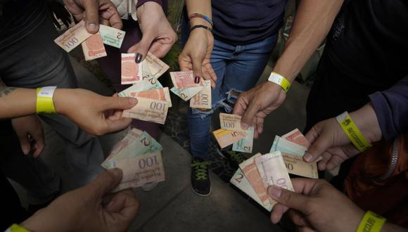 Sepa aquí a cuánto se cotiza el dólar en Venezuela este 24 de agosto de 2021. (Foto: AP)