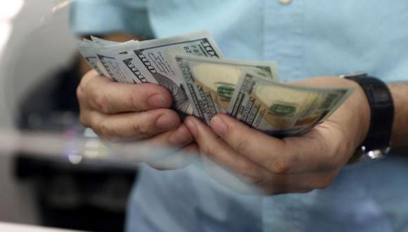 """El """"dólar blue"""" se negociaba en 147 pesos en el mercado marginal de Argentina. (Foto: AFP)"""