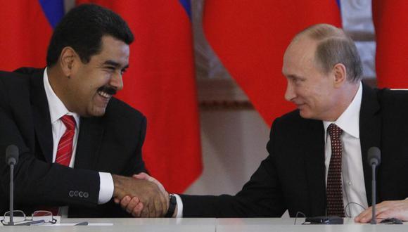 El presidente de Venezuela, Nicolás Maduro, y su homólogo de Rusia Vladimir Putin en una imagen del 2 de julio del 2013 en Moscú. (AFP PHOTO / POOL/ MAXIM SHEMETOV).