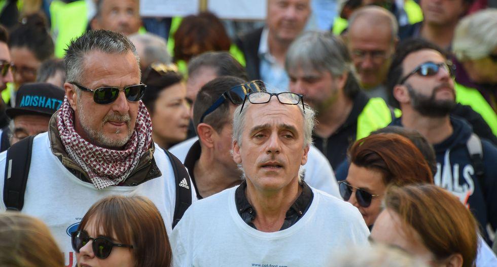 Imágenes de la nueva protesta de los chalecos amarillos en la víspera de los 3 meses desde el inicio de las manifestaciones contra las políticas del presidente de Francia, Emmanuel Macron. (AFP)