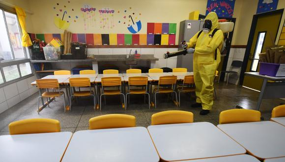 El Gobierno de Amazonas informó que ha invertido unos 10 millones de reales para readaptar los colegios a la pandemia de coronavirus COVID-19. (Foto referencial/EVARISTO SA/AFP)