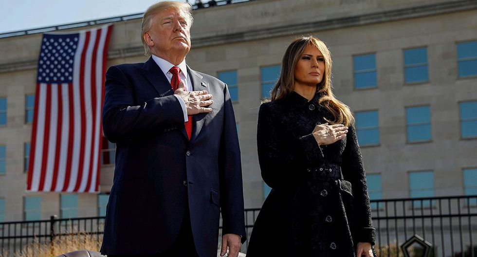 U.S. President Donald Trump and First Lady Melania Trump attend the 9/11 observance at the National 9/11 Pentagon Memorial in Arlington, Virginia, U.S., September 11, 2017. REUTERS/Kevin Lamarque     TPX IMAGES OF THE DAY