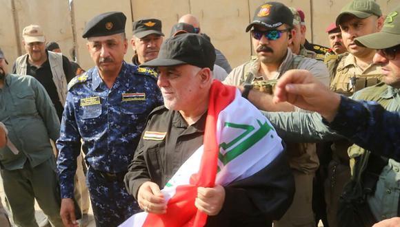 """El primer ministro de Iraq, Haider Al Abadi, proclamó victoria en Mosul, una ciudad """"liberada"""" tras una batalla de casi nueve meses contra los yihadistas del grupo Estado Islámico (EI). (Foto: AFP)"""