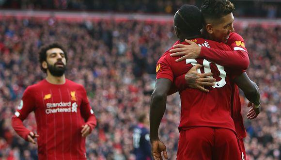 Liverpool es el primer equipo de la historia del fútbol británico que gana el título con siete jornadas de antelación | Foto: AFP