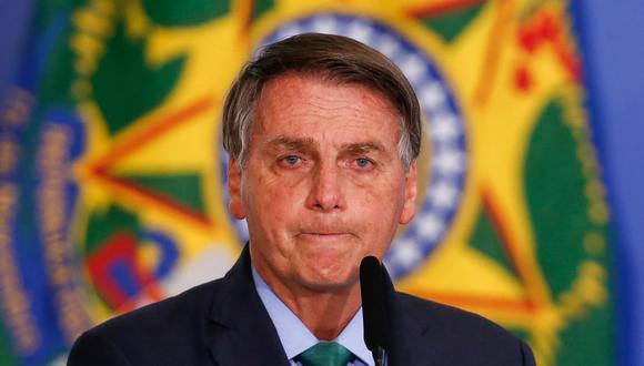 El presidente de Brasil, Jair Bolsonaro, reacciona durante una ceremonia en el Palacio Planalto en Brasilia, el 5 de agosto de 2021. (Foto de Sergio Lima / AFP).