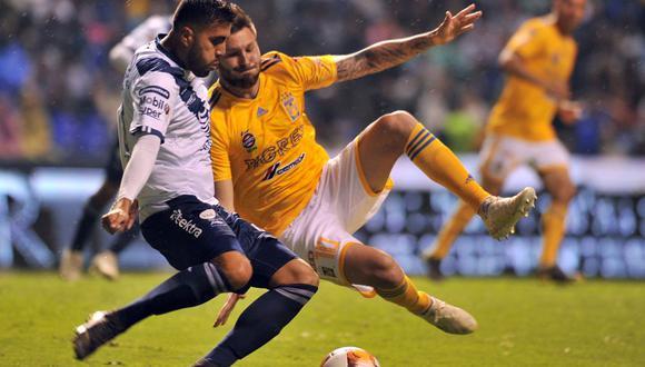 Con un gol del delantero argentino Matías Alustiza, Puebla rescató un empate de 1-1 ante Tigres el viernes para mantenerse dentro de zona de liguilla. (Foto: AFP)