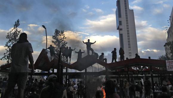 """""""El mundo vive tiempos violentos en lo económico, político y social"""", indica Lavado. (Photo by Pablo VERA / AFP)"""