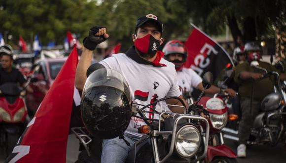 Los partidarios del Frente Sandinista de Liberación Nacional (FSLN) participan en una caravana en Managua, el 18 de julio de 2020. (Foto referencial: INTI OCON / AFP).