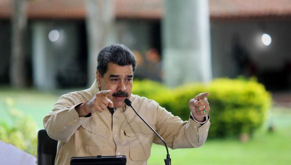"""Estamos mejorando en la lucha contra la pandemia y para el 6 de diciembre vamos a estar en una mejor situación"""", señaló Nicolás Maduro, invitando a miembros del bloque izquierdista a las elecciones parlamentarias de diciembre. (Foto: Presidencia Venezuela / AFP)"""