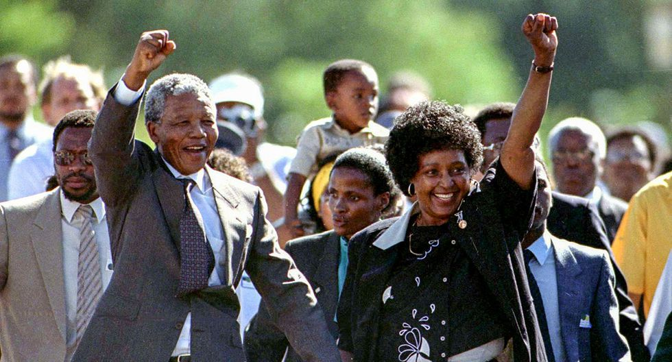 FILE PHOTO: President Nelson Mandela is accompanied by his then wife Winnie, moments after his release from prison near Paarl, South Africa,  February 11, 1990. REUTERS/Ulli Michel/File Photo