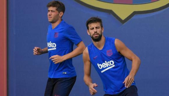 Gerard Piqué y Sergi Roberto entraron en la convocatoria de Barcelona para el clásico. (Foto: AFP)