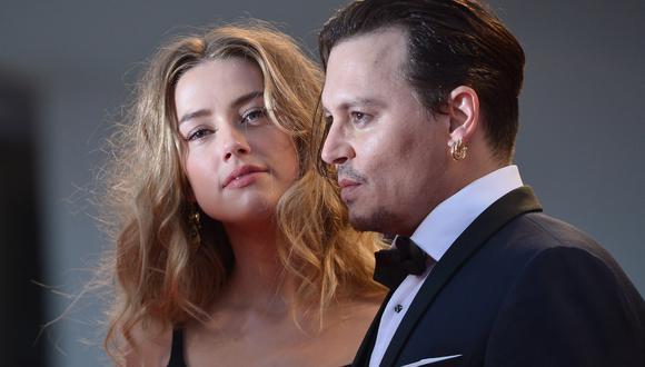 Johnny Depp y Amber Heard en su visita al Festival de Venecia en 2015. (Foto: Giuseppe Cacace y Tiziana Fabi para AFP)
