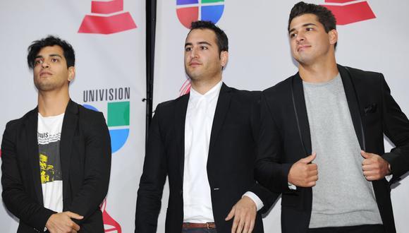 Gilberto Espinoza (Izq.), Jesus Rosas, (Centro) y Julio Eguia (Der.) del grupo de rock mexicano Reik continuaron con su trabajo pese a la pandemia (Foto: ROBYN BECK / AFP)