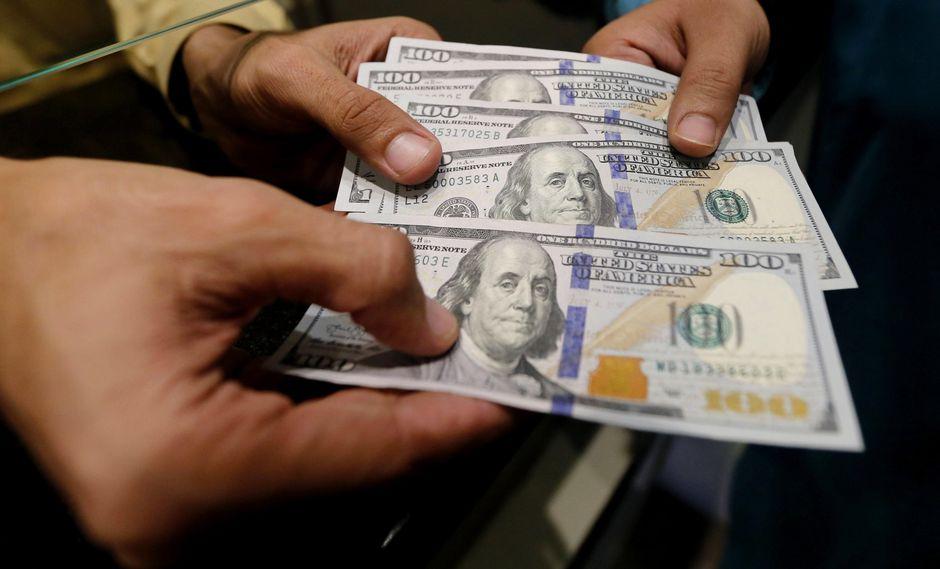 El dólar se vendía hasta enS/3.584 en los principales bancos de la ciudad este martes.(Foto: EFE)