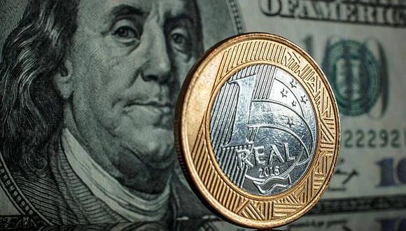 El lunes la divisa brasileña cerró en su mínimo histórico de fin de operaciones, de 4,2179 reales por billete verde. (Foto: AFP)