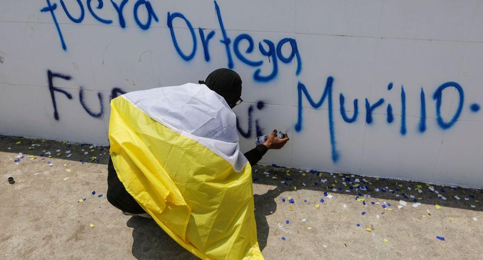 Las procesiones religiosas del Viernes Santo en la capital de Nicaragua adquirieron un tono político, ya que fueron aprovechadas por algunos para manifestarse contra el gobierno del presidente Daniel Ortega. (Foto: AFP)