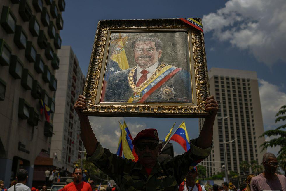 Los chavistas salieron a las calles a celebrar el primer año de la reelección de Nicolás. Maduro. (AFP).