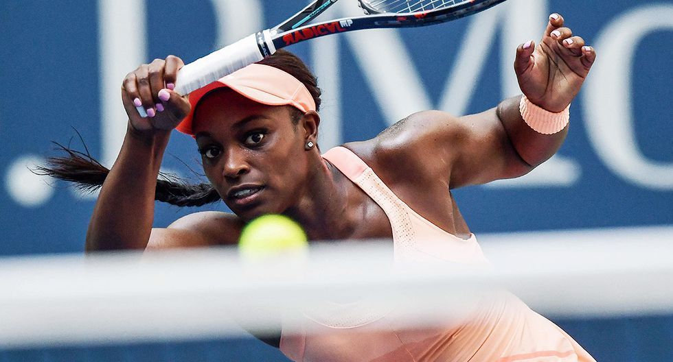 Sloane Stephens of the US returns the ball to Anastasija Sevastova of Latvia during their 2017 US Open Women's Singles Quarterfinal match at the USTA Billie Jean King National Tennis Center in New York on September 5, 2017.