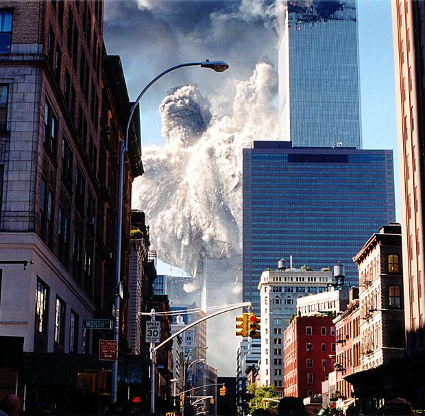 The south tower of the World Trade Center is collapsing.  (AFP Photo / Aaron HITO).