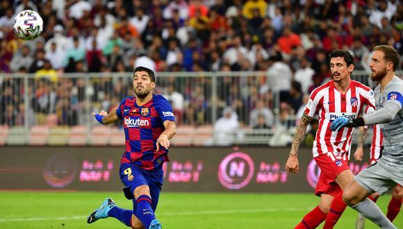 Suárez enfrentó al Atlético de Madrid en 18 partidos, con un saldo de 11 victorias, 5 empates y 2 derrotas. (Foto: AFP)