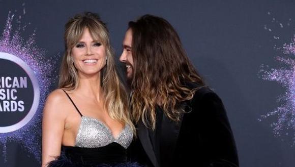 La modelo Heidi Klum y su esposo, el guitarrista Tom Kaulitz en los American Music Awards. (Foto: AFP)